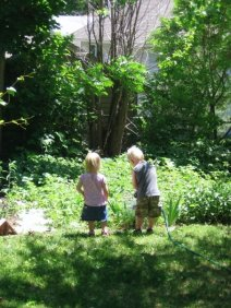 Our nephew & niece, Micah & Hannah, enjoy the garden.